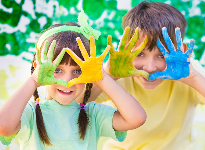 Two children with paint covered hands - keep your home tidy